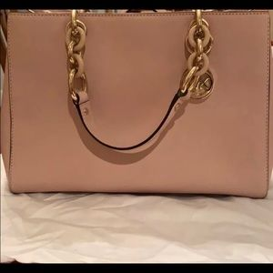 Pink satchel with a crossbody attachment